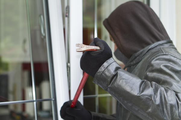 Burglar breaking into a residential property
